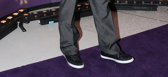 Sneakers while suited